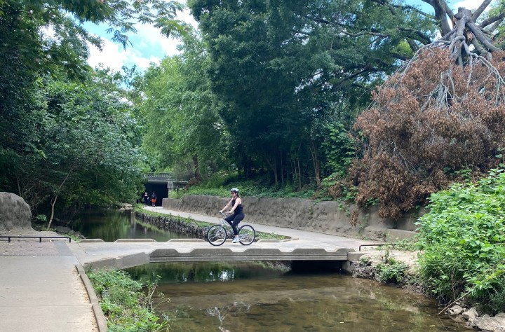 photo of me biking on the Little Sugar Creek Greenway