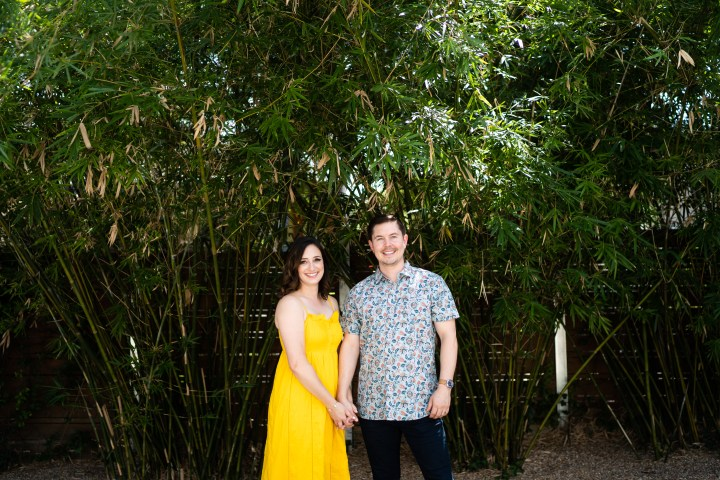 photo of couple in front of greenery in austin tx