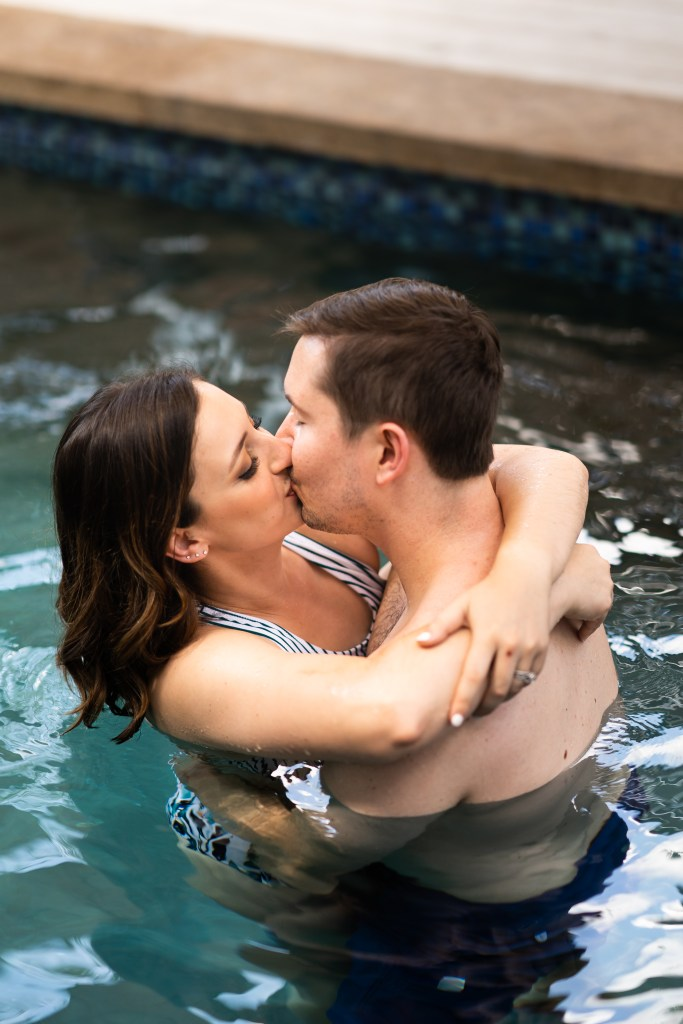 photo of kissing in the pool