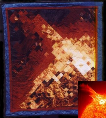 Quilt of a solar flare. About 3.5x4 ft. Cotton and partially bleached satin.