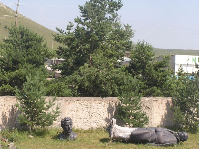 Toppled soviet statue outside the police station in Akalkalake