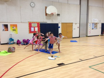 """Making room for all during """"take-off"""" for airplane pose after a game of """"musical mats."""""""