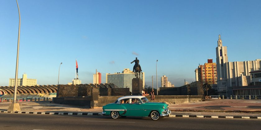 classic car driving the Malecon