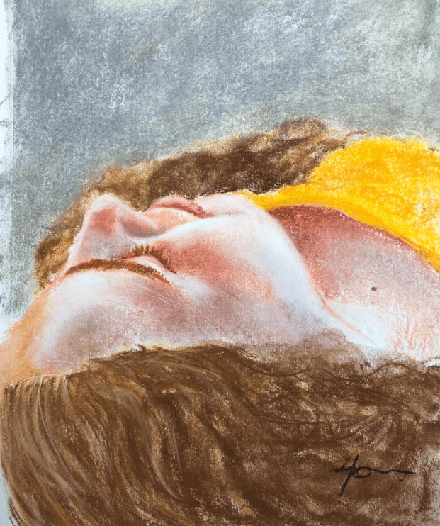 Pastel drawing of the side profile of a young white woman who is laying down. She is wearing a yellow top, and her hair is curly brown-blonde. Her eyes are closed.