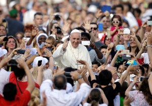 Pope Francis blesses the faithful as he arrives on the occasion of an audience with participants of Rome's diocese convention in St. Peter's Square, at the Vatican, Sunday, June 14, 2015. (AP Photo/Gregorio Borgia, Pool)