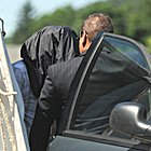 man who testified against Sandusky leaving courthouse with a black bag covering his head