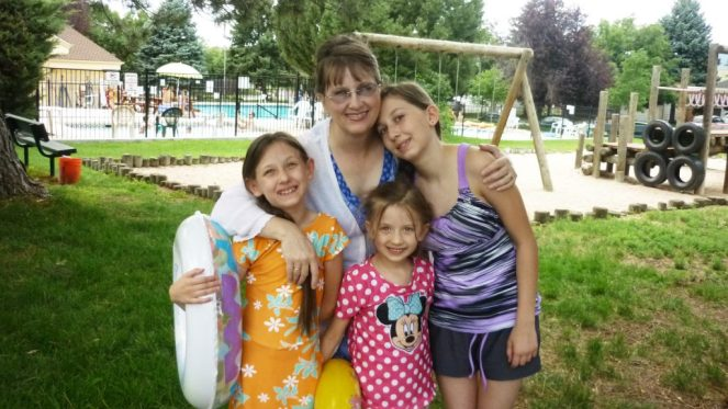 mom and the girls at the swimming pool