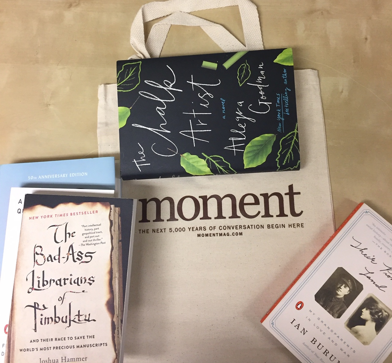 Moment tote bag and books