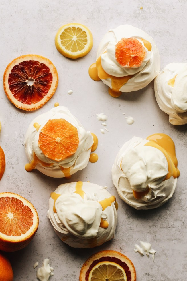 this is how the mini pavlovas look filled with blood orange curd, then topped with whipped cream and slices of blood oranges.
