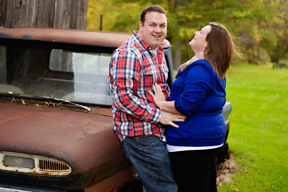 Cornwall Engagement Session - man in red shirt leaning on car
