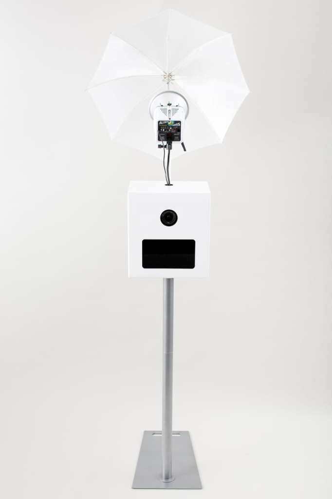all-in-one white photo booth unit with umbrella on top