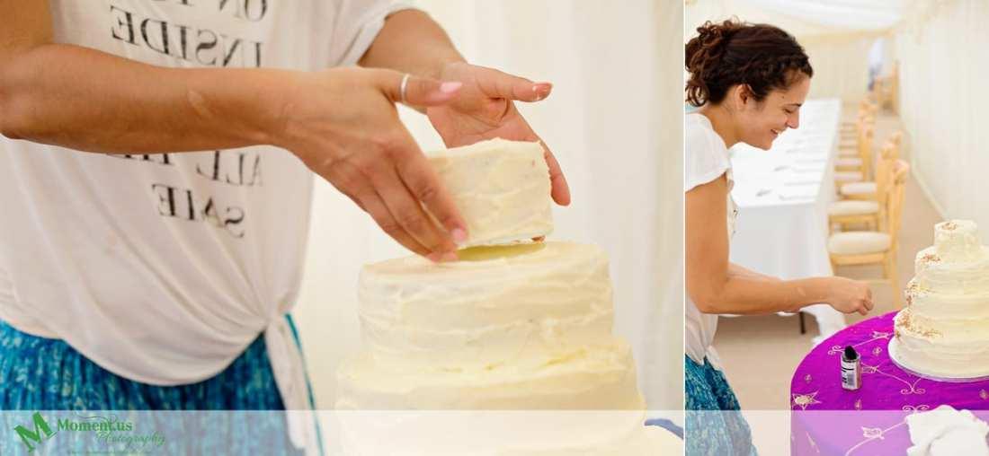 Fort Belan Wedding - bride assembling cake
