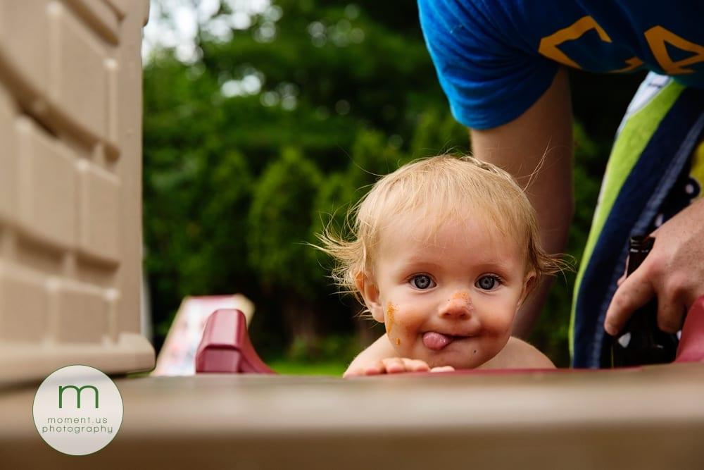 boy climbing up slide