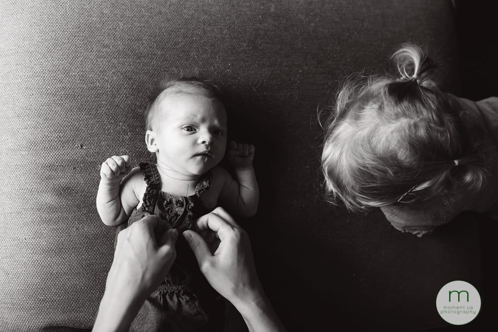 mother dressing baby