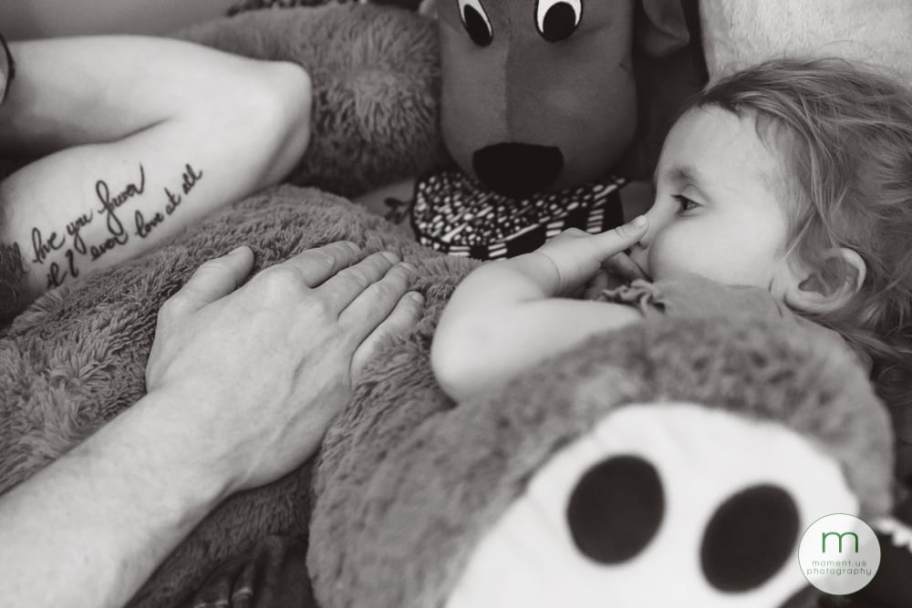 girl and dad on bed
