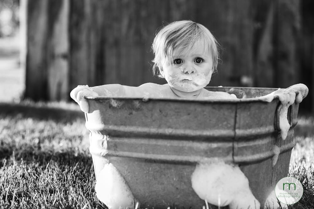 Cornwall child in tub making serious face