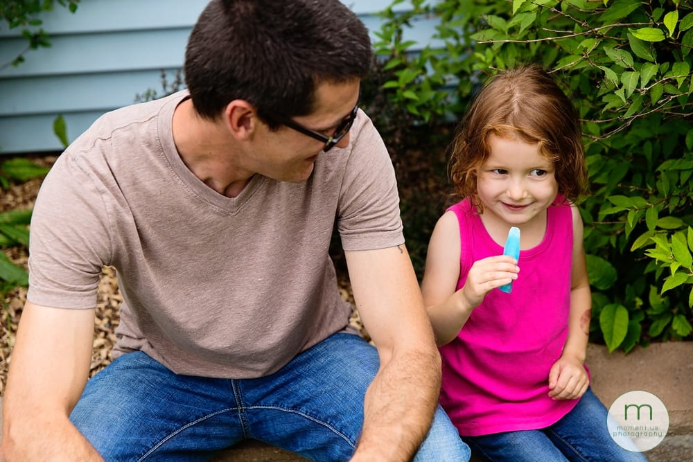 Cornwall girl eating popsicle with dad