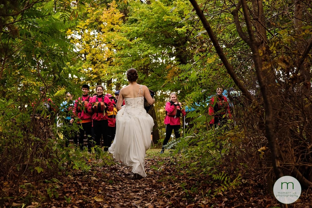 bride walking towards kayakers