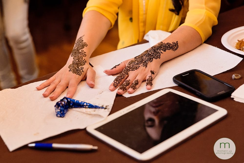 bride's hands and face during mehndi