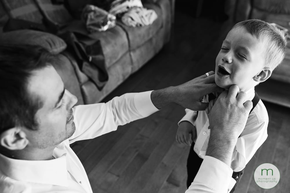 ring bearer getting dressed and choking