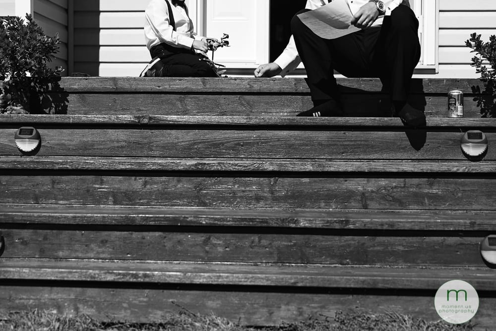 ring bearer and groomsman on front steps