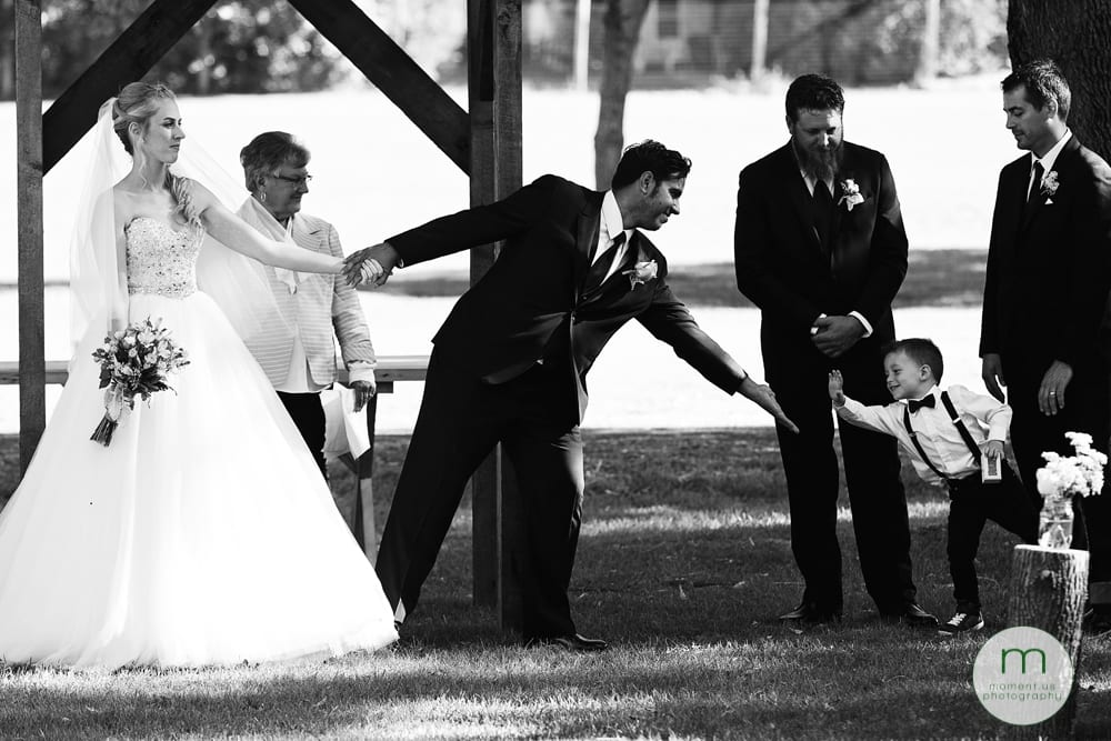 groom getting high five from ring bearer