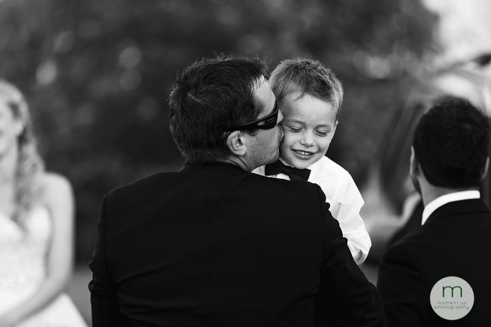 groomsman kissing son