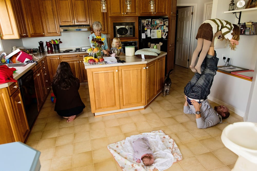 Cornwall family photographer - whole family in kitchen