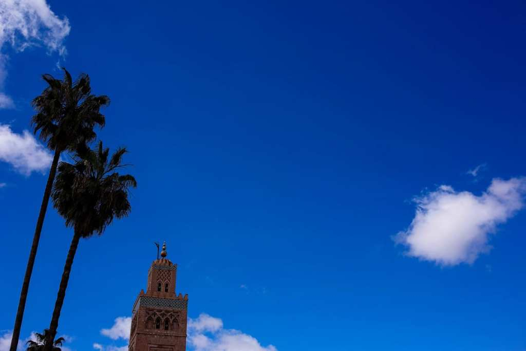Wedding photographer in Morocco - Koutoubia mosque against blue sky