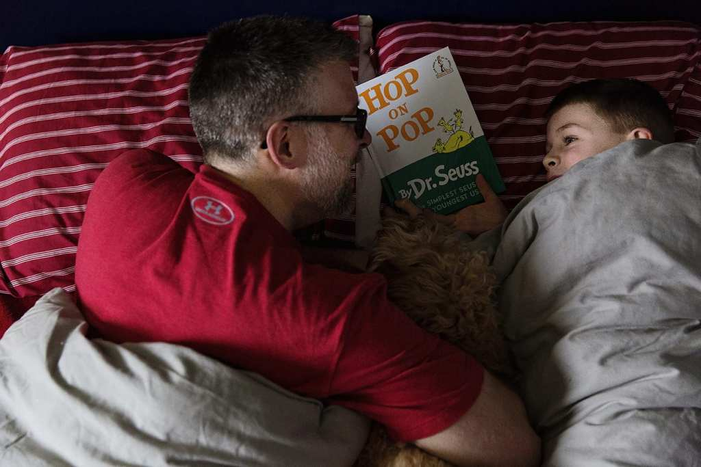 dad and son reading dr seuss