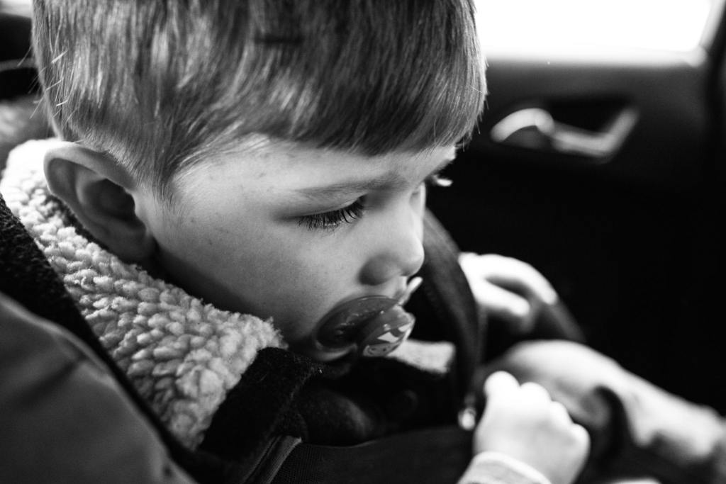 boy sitting in car during South Wales family session