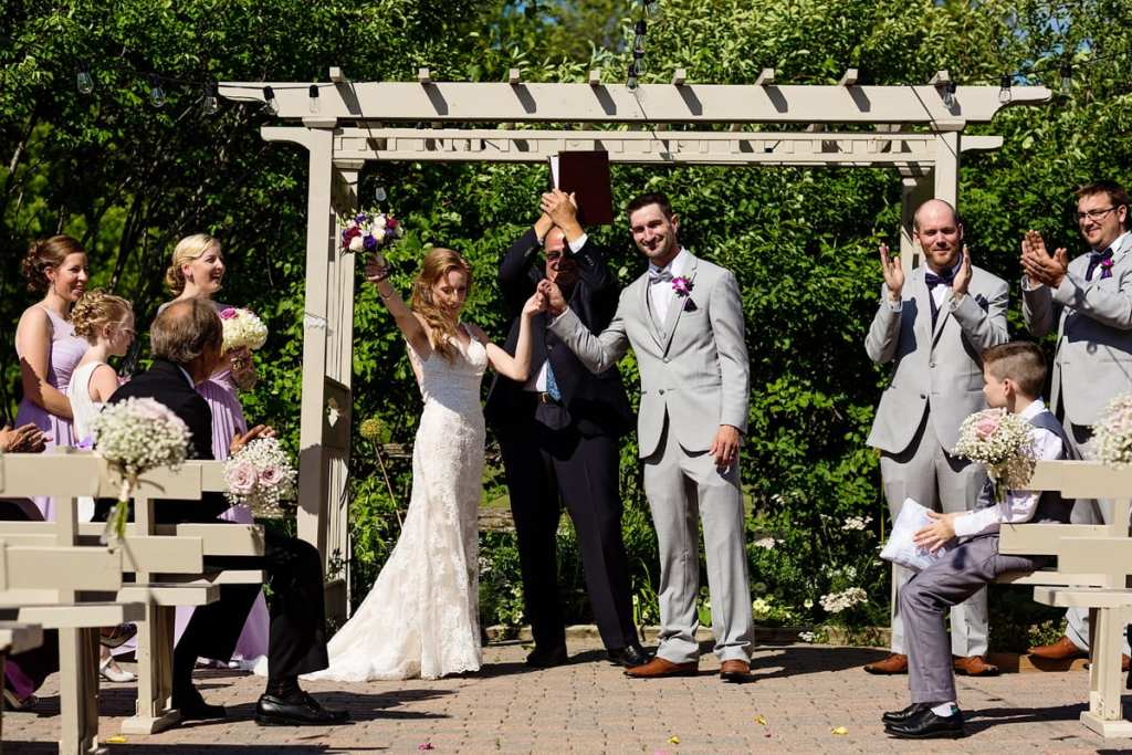 Bride and groom celebrating officially being married at intimate Strathmere wedding