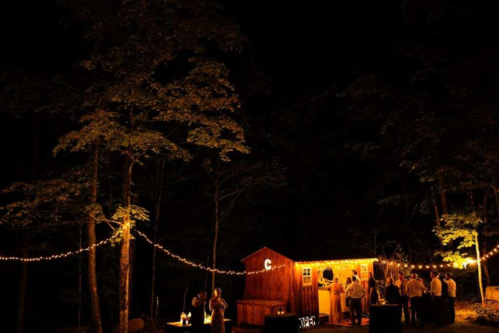 Rural Ontario backyard wedding reception with cabin bar
