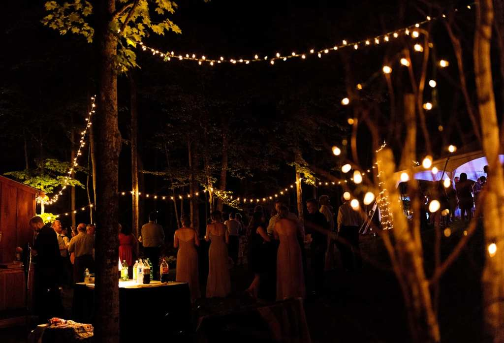 Rural Ontario backyard wedding reception outside with string lights