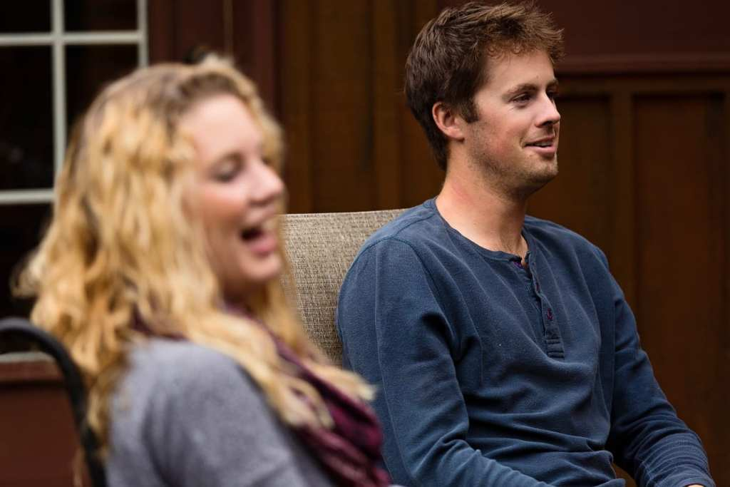young couple laughing at jokes with family in casual ontario family session