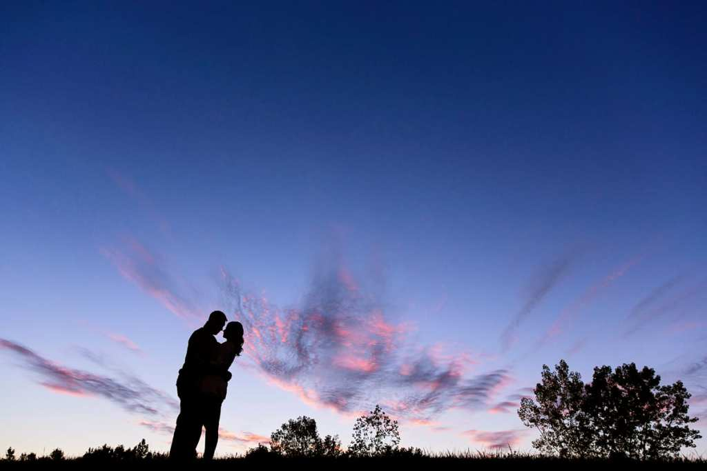 sunset fall engagement session with silhouetted couple