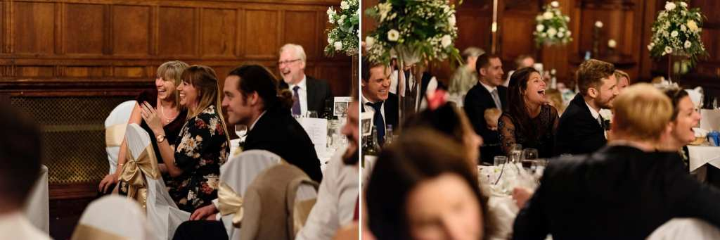 Dinner guests laugh boisterously during dinner reception at Rhinefield House