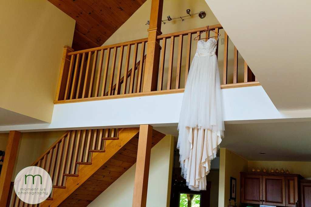 dress hangs from balcony before Calabogie wedding