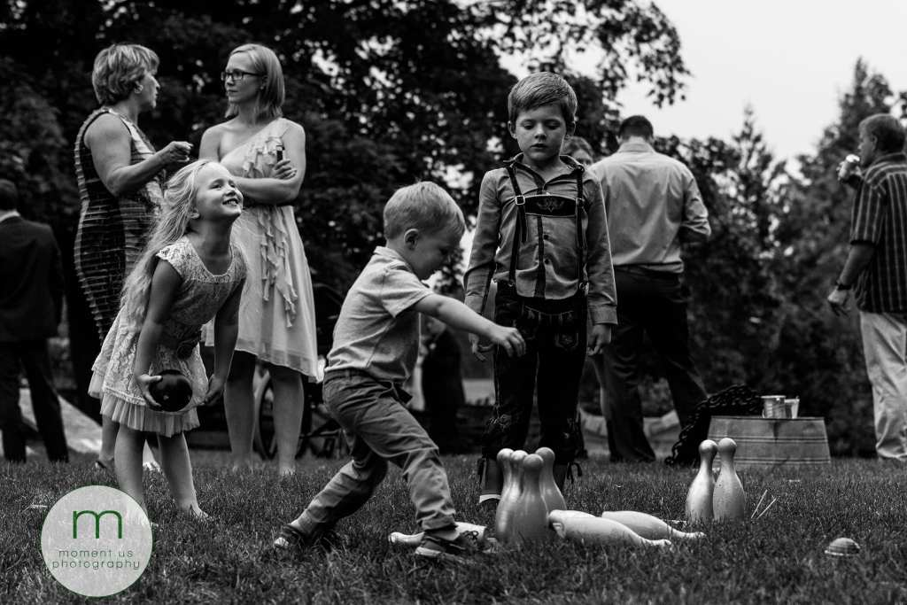children play lawn bowling and pins fall down