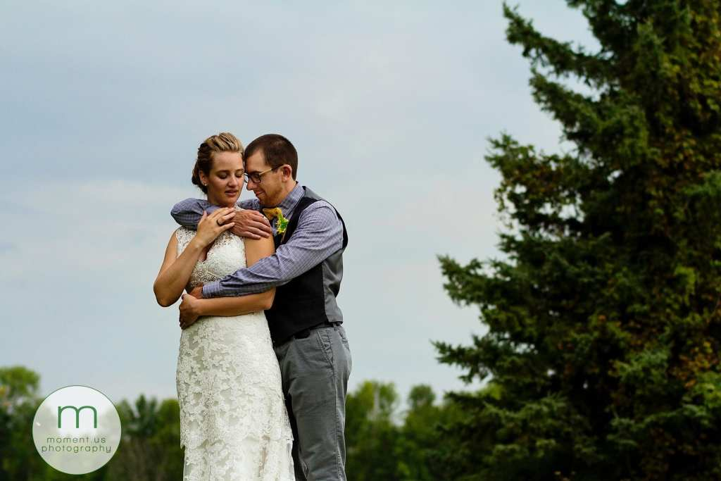 groom holds bride close during Ontario & Quebec Wedding Photography portraits