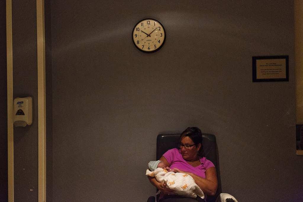 Grandma holds new grandson in quiet hospital room