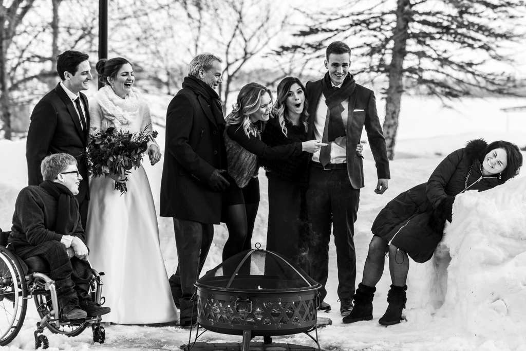 Family reacts in shock as mother falls in snowbank during Chateau Montebello wedding family formals