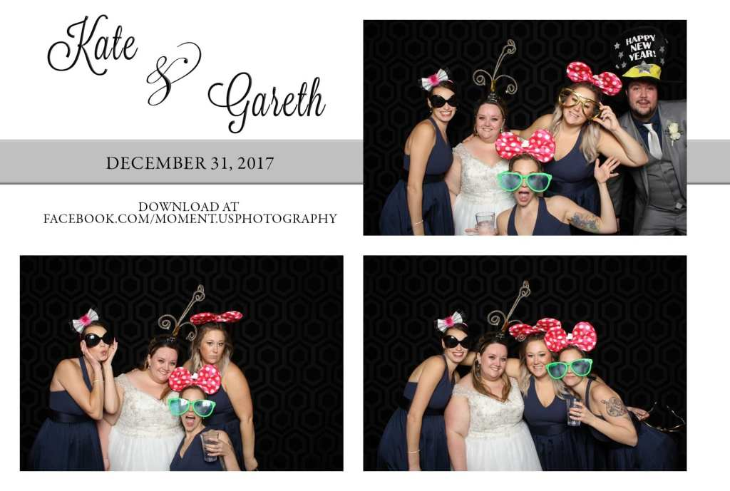 girls wearing Minnie Mouse ears standing with bride in front of black backdrop for wedding photo booth