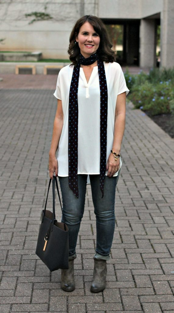 Fall Outfit idea: Pair a skinny scarf with a tunic, jeans and ankle boots. See three different ways to tie a skinny scarf for different looks.