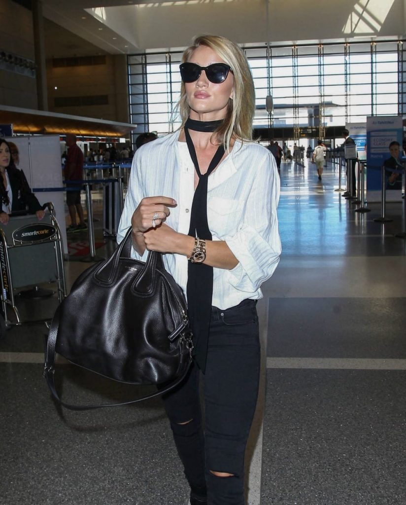 Skinny scarf outfit idea - Rosie Huntington Whitely sports a skinny scarf while at the LAX airport.