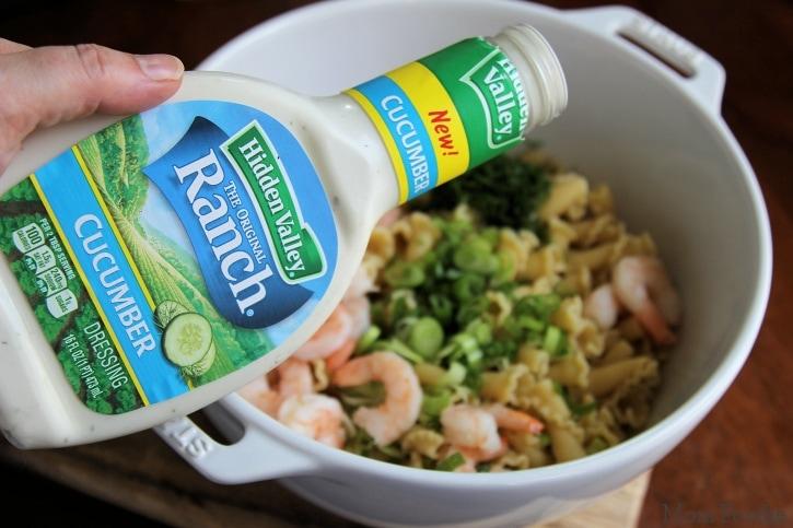 putting Hidden Valley Cucumber Ranch Dressing in pasta salad