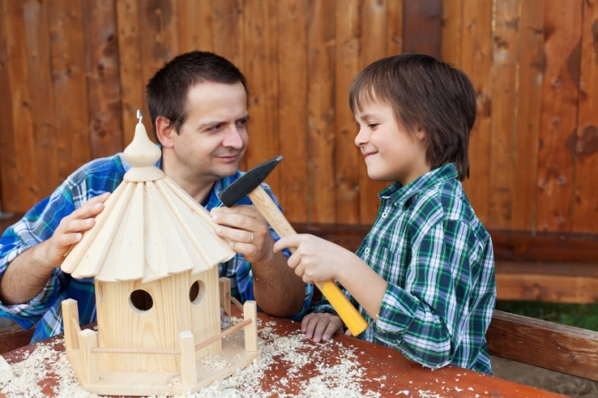 kid building birdhouse for garden