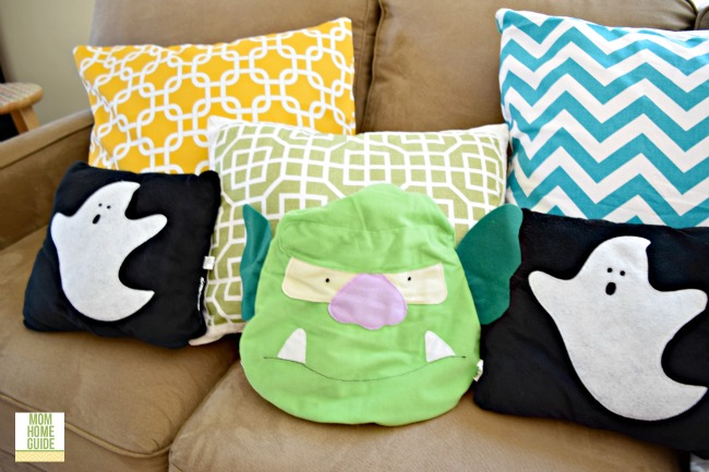 Halloween throw pillows on love seat