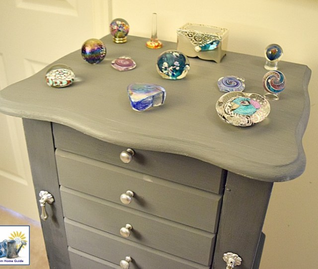 Jewelry Armoire Decorated With Beautiful Glass Paperweights