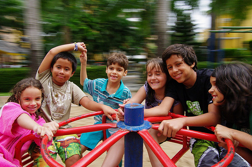 Kids laughing on a merry-go-round